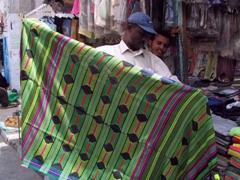 Abdul showcases the Wadi Hadramawt style futa in Mukalla's souq