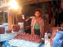 Local boy selling dates at the Suq al-Milh, Sana'a