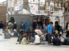 Children playing cards in Bab al Yemen Square, Sana'a