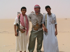 Robby posing with our bedouin escort (Monsoud and Ali) for the desert crossing to Seyun