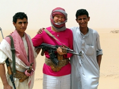 "Becky AKA ""Hani-Baba"" poses with Bedouin tour guides, Safer Desert"
