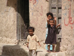 Happy Al-Hajarain children greet us