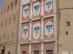 Facade of a colorful adobe, Al-Hajarain