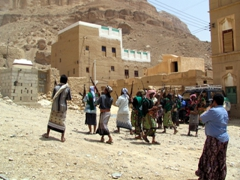 Revelers firing off their AK-47s, Yemeni wedding celebration in Wadi Douan