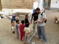 Robby befriending local children, Shibam old city