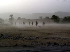 Boys playing a soccer game despite the onslaught of the sand-storm, Shibam