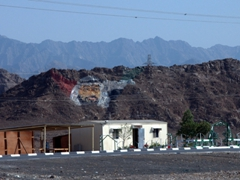 Image of Sheikh Mohammed bin Rashid Al Maktoum, the constitutional monarch of UAE, superimposed on the mountainside near Masafi