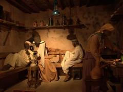 Men relaxing with their shisha pipes; Ajman Museum display