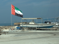 A massive UAE flag beside the Sharjah waterfront