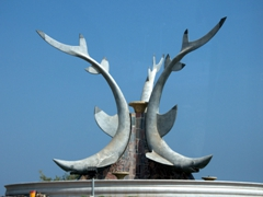 A shark statue at a traffic roundabout; Fujairah