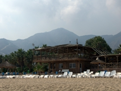 The rugged Hajer Mountains overlooking a beach resort in Fujairah