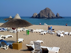 View of Snoopy Island, a popular dive site in the Gulf of Oman; beachfront of Sandy Beach Hotel; Fujairah