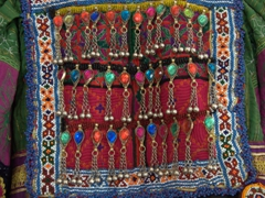 View of the intricate bead and embroidery work on the bodice of a souvenir dress; Souq al-Arsa