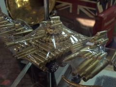 Recycled shell casings used to make souvenir tanks and aircraft; Souq al-Arsa