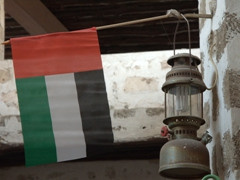 UAE flag above a lantern in the Souq al-Arsa, considered one of the most atmospheric souqs in the UAE