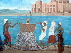 The brightly colored fishing mural is a dead giveaway for the Dubai Fish Market, a must for the first time visitor