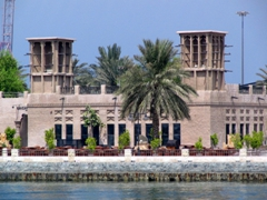 Beautifully restored buildings, such as this one complete with wind towers, line the Dubai waterfront