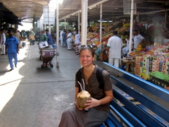 Becky enjoys some coconut juice while taking a breather in the sweltering summer heat