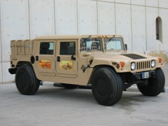 A HMMWV with traditional desert scenes painted on each door; Abu Dhabi