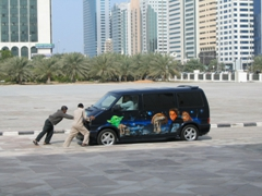 """""""May the force be with you""""...locals struggle to push a stalled Star Wars theme van; Abu Dhabi"""