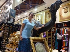 Becky poses next to a life sized camel statue; The Dubai Mall