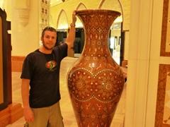 Robby poses next to a gigantic vase; Dubai Mall
