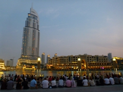 Visitors gather for the nightly free choreographed fountain light and music display at the Dubai Fountain