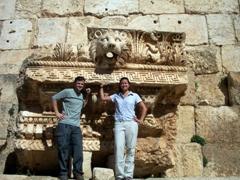 Posing before cornice detail from Temple of Jupiter, Baalbek