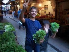 Friendly Lebanese boys flashing the peace sign; Tripoli souk