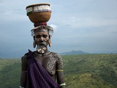 Mursi woman wearing a clay lip plate; Omo Valley in Ethiopia