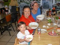 Enjoying pho in San Antonio, TX with Gracie and Frannie