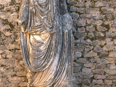 This headless statue represents one of the Licinii family members who donated the baths to the city in the third century AD; Licinian Baths