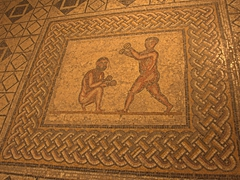 Roman mosaic of boxers with wrapped hands
