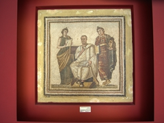 World famous mosaic of the great Latin poet, Virgil, holding a volume of the Aenid