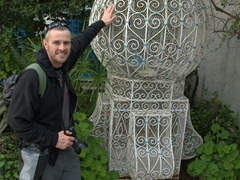 Robby strikes a pose next to a massive bird cage