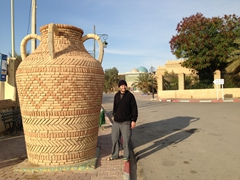 Robby next to a massive jug near Dar Charait Museum