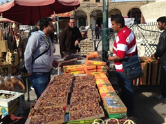 Ala bargains for dates (Tozeur has the reputation of the country's best dates and a bargain at only 3 Dinar per KG)