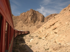 "Riding the antique train ""Lezard Rouge"" through the Seldja Gorge"