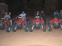 Happy smiles all around after our quad bike ride at Ksar Ghilane