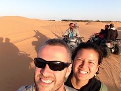 Enjoying our quad bike ride through the sand dunes of Ksar Ghilane