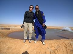 Becky and Ali at a hot spring near Ksar Ghilane