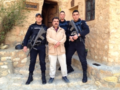 Our chef poses next to the security detail charged with our safety; Residence Kenza