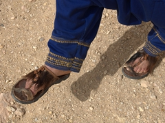 Our tour guide for the day (Ismail) shows off the hand crafted sandals his father made for him...stylish and practical!