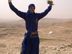 "Ismail demonstrates the Berber symbol of ""free man"" which is embroidered on his clothes"