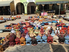 Colorful ceramics on display at the artisanal market of Tataouine
