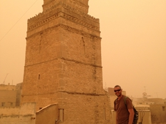 Robby beside Sfax's elaborate sandstone minaret at the Great Mosque
