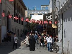 Bustling souq scene near Zaytouna Mosque
