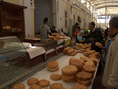 Buying fresh bread at the Tunis Central Market