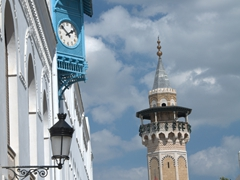 Clock tower and minaret in Tunis medina