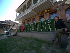 "Becky beside the ""I love Tbilisi"" sign"